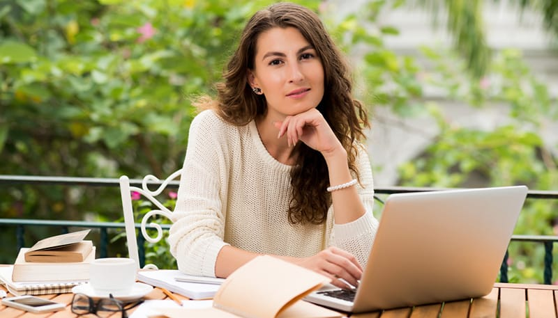 woman at laptop thinking of online businesses to start