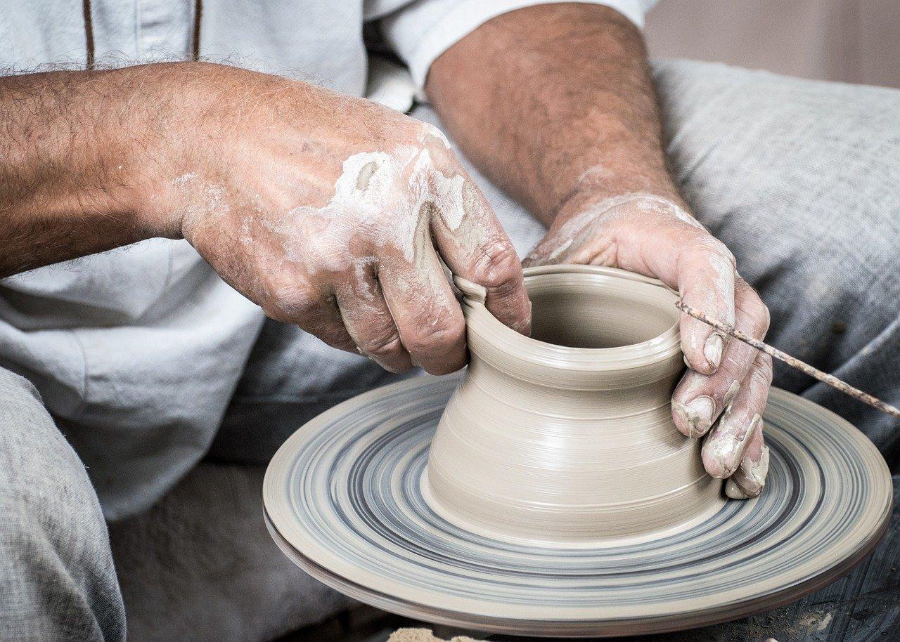 making pot on spinning wheel