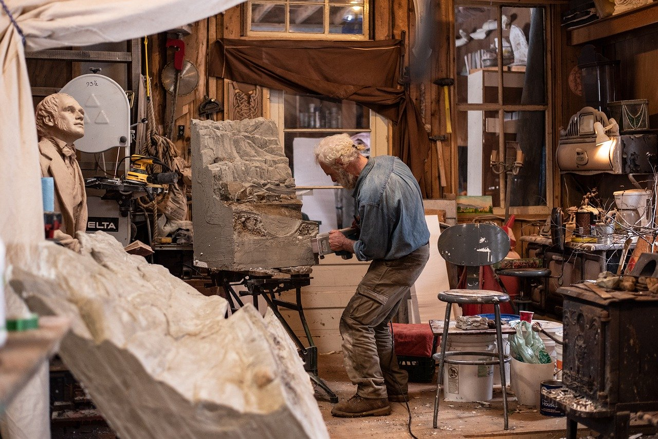 sculptor in art workshop