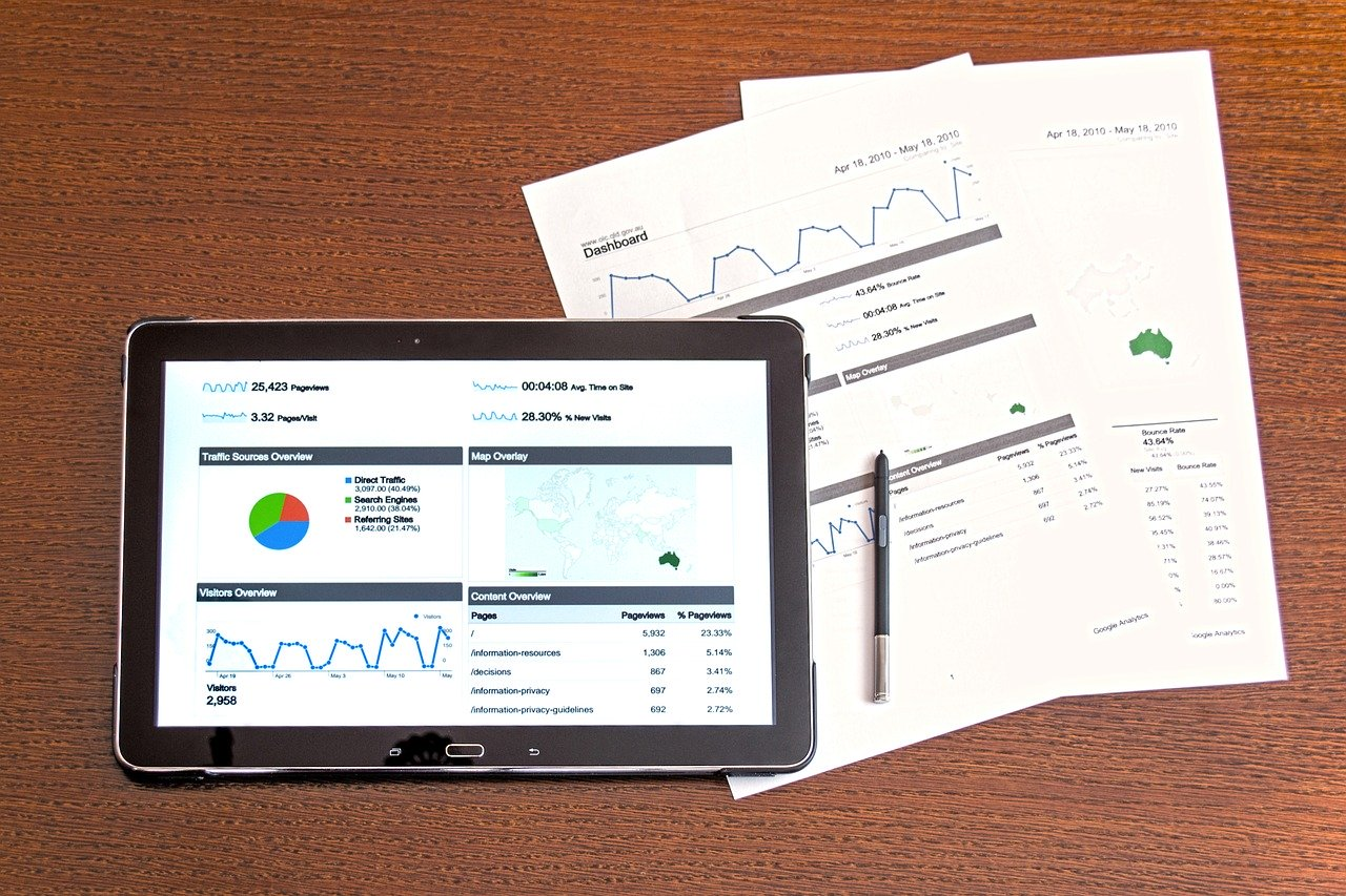 investing information paper and tablet