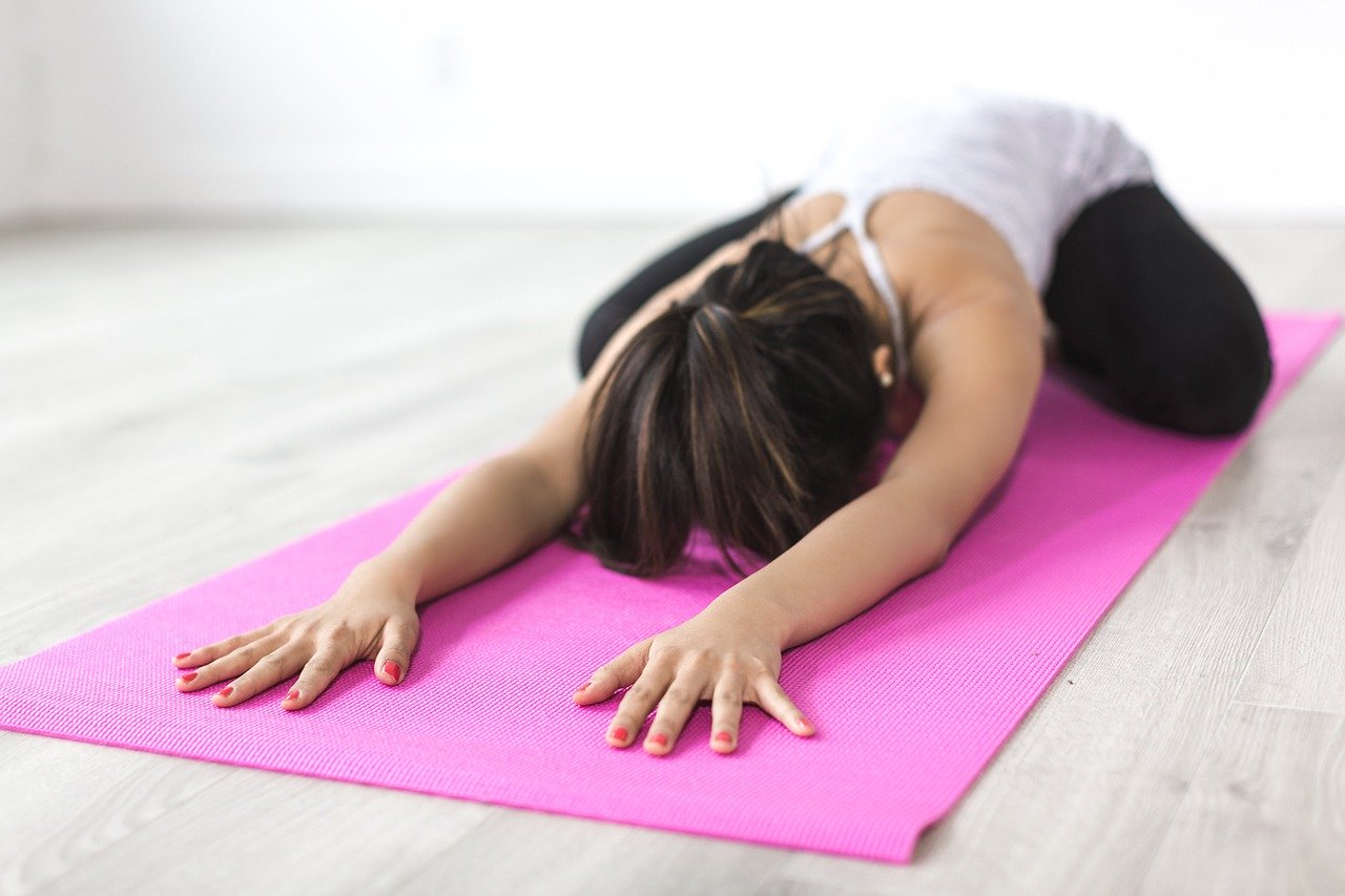 yoga instructor on mat