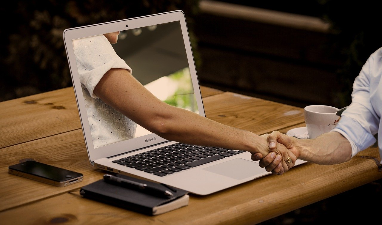handshake from laptop